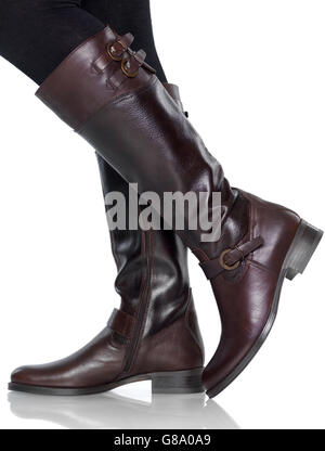Closeup of knee-high brown leather lady's boots - Stock Photo