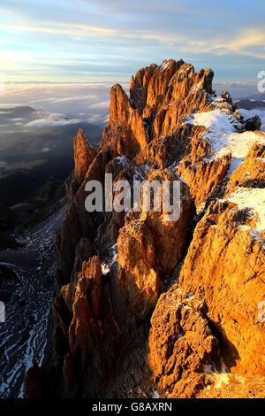 Aerial shot of Sassolungo at sunset Sella Group Val Gardena Dolomites Trentino Alto Adige Italy Europe - Stock Photo