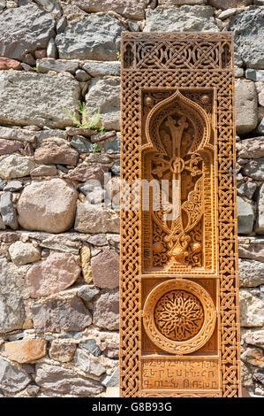 Finely engraved Khachkar at Gaghard, Armenia. - Stock Photo