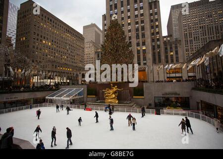 Skaters in Rockefeller Plaza, New York City - Stock Photo