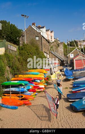 UK, Wales, Ceredigion, New Quay, guides preparing windsurfer sails - Stock Photo