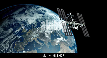 ISS - International Space Station orbiting Earth - Stock Photo