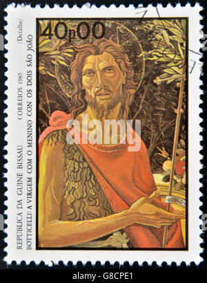GUINEA BISSAU - CIRCA 1985: a  stamp printed in  Guinea-Bissau  shows St. John the Evangelist by Botticelli, circa - Stock Photo