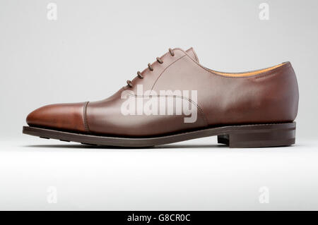 Brown man's shoe in profile isolated on grey graduated background - Stock Photo