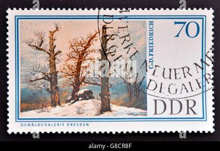 GERMANY - CIRCA 1967: A stamp printed in Easter Germany shows Dolmen in snow by Caspar David Friedrich, circa 1967 - Stock Photo