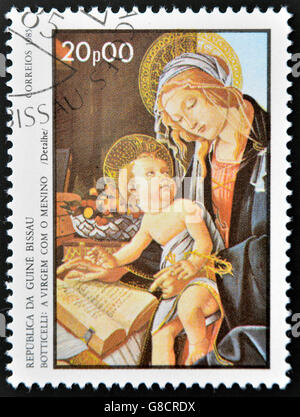 GUINEA BISSAU - CIRCA 1985: a stamp printed in Guinea-Bissau showsthe Virgin and Child by Botticelli, circa 1985 - Stock Photo