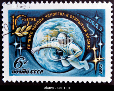USSR- CIRCA 1975: A stamp printed in USSR devoted primary Extra-vehicular activity, circa 1975 - Stock Photo