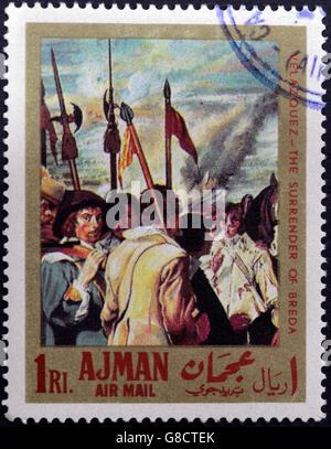 AJMAN - CIRCA 1968: A stamp printed in Ajman shows 'the surrender of Breda' by Velazquez, circa 1968 - Stock Photo