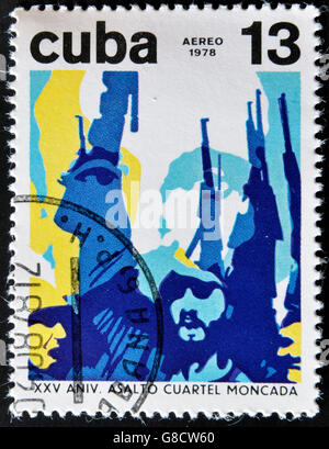 CUBA - CIRCA 1978: A stamp printed in Cuba shows Fidel Castro with rifle raised celebrating the assault on the Moncada - Stock Photo