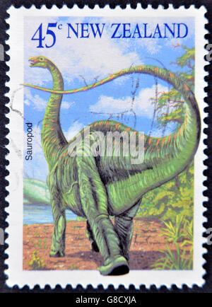 NEW ZEALAND - CIRCA 2004: A stamp printed in New Zealand shows image of a Sauropod, circa 2004 - Stock Photo