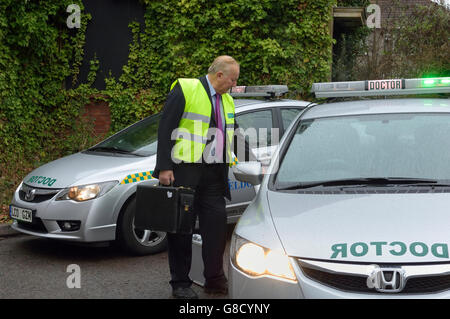 Doctor on call with car. England. UK. Europe - Stock Photo