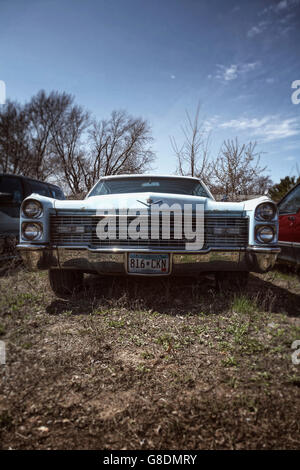 The front of an old rusting Cadillac, left in a yard in Minneapolis, Minnesota, USA. - Stock Photo