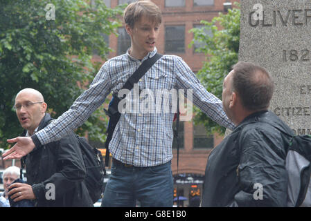 Manchester, UK. 28th June, 2016. A person campaigning for 'Undo Brexit' (centre) and 'Brexit' (right) on June 28th, - Stock Photo