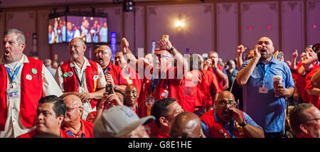Las Vegas, Nevada USA - 28th June 2016 - Outfitted in red vests, Teamsters convention delegates pledged to incumbent - Stock Photo