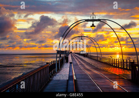 Southport, Merseyside, UK.   UK Weather. 28th June, 2016.  Dark storm clouds and a colourful June sunset over the - Stock Photo