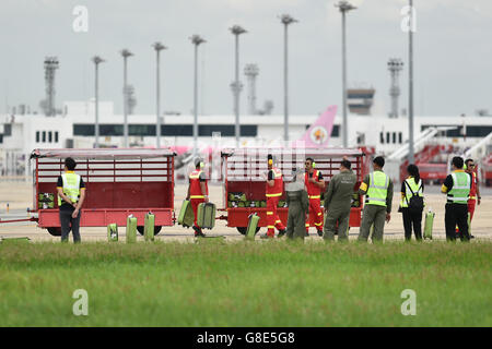 Bangkok, Thailand. 29th June, 2016. Ground crew members sort out luggages of 'passengers' evacuated from an Airbus - Stock Photo