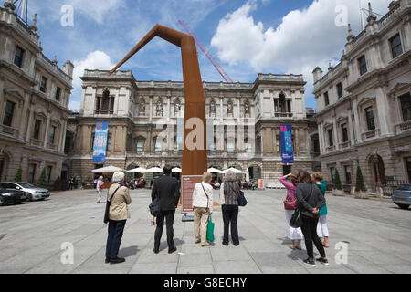 People viewing 'SPYRE' by artist Ron Arad exhibited in the Royal Academy of Arts courtyard, Piccadilly, London, - Stock Photo