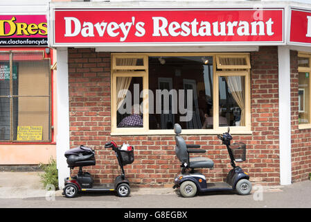 Davey's restaurant in Clacton UK with mobility scooters parked outside - Stock Photo