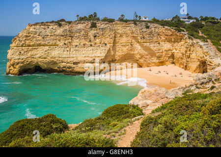 A view of beach in Benagil fishing village on coast of Portugal - Stock Photo