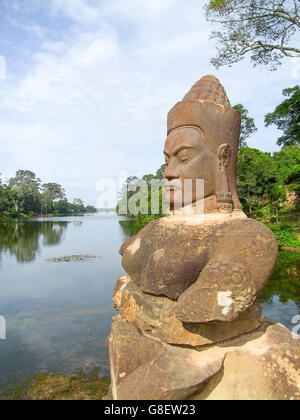 Temple detail at Angkor Thom showing a stone carved sculpture - Stock Photo