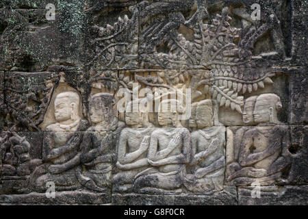 Mahayana Buddhist carvings showing arhats / boddhisattvas - on the side of the 12th or 13th Century Bayon temple, - Stock Photo