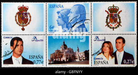 SPAIN - CIRCA 2004: Collection stamps shows Spanish royal family: Juan Carlos I and Sofia, Prince Felipe and Letizia - Stock Photo