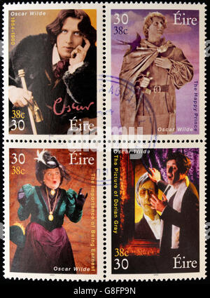 IRELAND - CIRCA 2000: Four stamps dedicated to Oscar Wilde, the most famous writer, poet and playwright Irish, circa - Stock Photo
