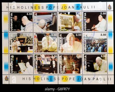 UDMURTIA - CIRCA 2003: Collection stamps printed in Udmurtia shows Pope John Paul II, circa 2003 - Stock Photo
