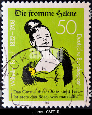 GERMANY - CIRCA 1982: A stamp printed in Germany dedicated to the 150th Birth anniversary of writer and illustrator - Stock Photo