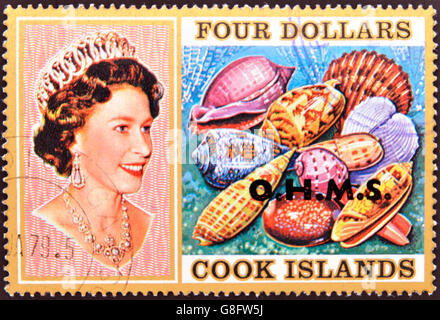 COOK ISLANDS - CIRCA 1974 : Stamp printed in Cook Islands shows Portrait of Queen Elizabeth II, with collection - Stock Photo