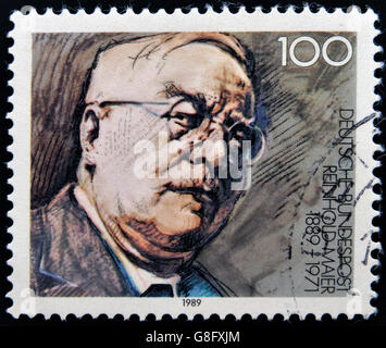 GERMANY - CIRCA 1989: A stamp printed in Germany dedicated to the 100th anniversary of the birth Reinhold Maier, - Stock Photo