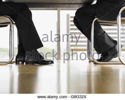 Feet under a table Stock Photo 12002412 Alamy