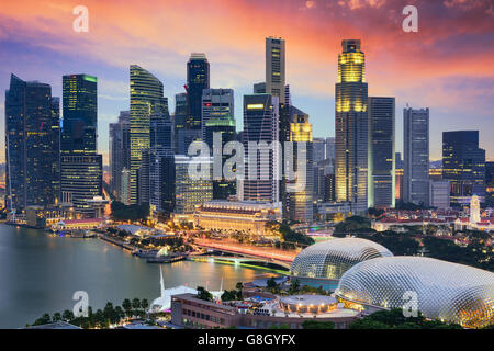 Singapore Financial District skyline at dusk. - Stock Photo