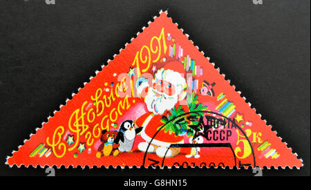 USSR - CIRCA 1991: A stamp printed in Russia shows santa Claus, circa 1991 - Stock Photo