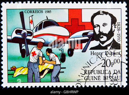 GUINEA BISSAU - CIRCA 1985: A stamp printed in Guinea Bissau shows Henry Dunant, founder of the Red Cross charity, - Stock Photo