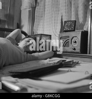 Young Woman Sleeping While Listening to Radio in Boardinghouse Room, Washington DC, USA, Esther Bubley for Office - Stock Photo