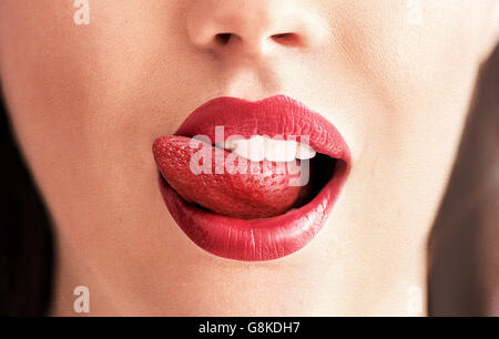 Conceptual image of a pure red strawberry tongue - Stock Photo