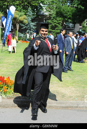 One male student graduate in full gown with hat expressing enormous joy on graduation day at Queen Mary London University. - Stock Photo