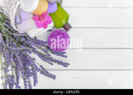 Lavender and a basket with gels on white boards. Still life. - Stock Photo