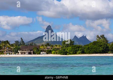 Beach of Flic en Flac with Piton de la Petite Riviere Noire Mauritius. - Stock Photo