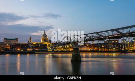 Stunning lights of dusk on the Millennium Bridge at Bankside, London, UK. - Stock Photo