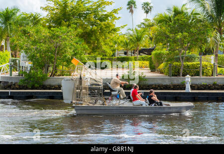 Everglades City Florida airboat with tourists riding on water in downtown center - Stock Photo