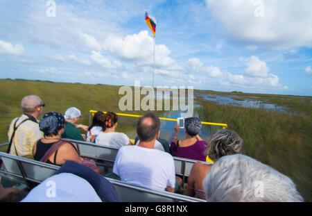 Everglades City Florida airboat ride fast with tourists riding on water wetlands of Everglades at Miccosukee Indian - Stock Photo