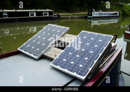 Solar panels on the roof of a canal narrow boat - Stock Photo