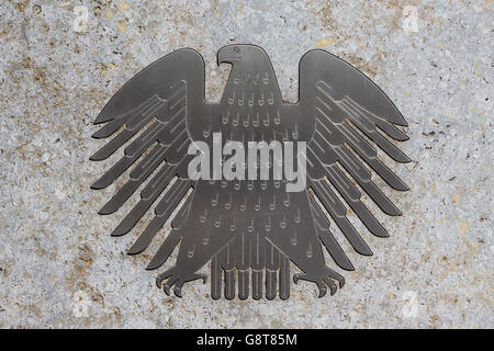 The german eagle (Bundesadler), the logo of the German Bundestag at the Bundestag building. - Stock Photo