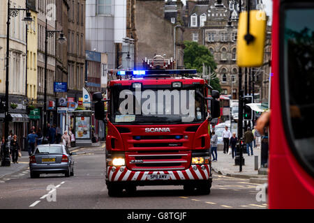 Scottish Fire And Rescue Service Fire Engine responding to a 999 Emergency call along the Overgate in central Dundee, - Stock Photo