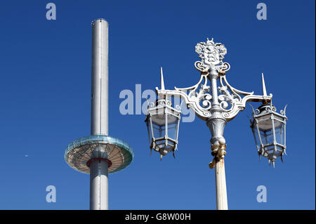 Contrasting styles of design on Brighton seafront: the new i360 vertical cable car and a traditional lamppost. - Stock Photo