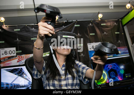Tokyo, Japan. 30th June, 2016. A woman tests a VR VISION Pro virtual reality glasses at Content Tokyo 2016 in Tokyo - Stock Photo