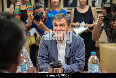 Greek Finance Minister Efklidis Tsakalotos smiles during a visit of the German Vice Chancellor and Economy Minister - Stock Photo