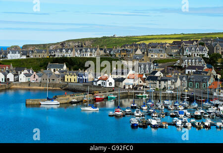 Findochty Harbour with town behind at the Moray Firth, Findochty, Scotland, Great Britain - Stock Photo